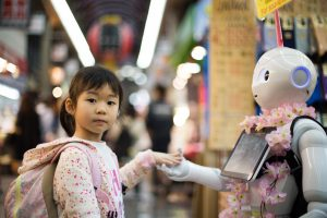 artificial-intelligent-robot-holding-child's-hand